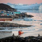A passenger boat in the Disko Bay near Ilulissat in Greenland on a foggy day