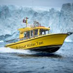 Ilulissat Water Taxi cruising along the Ilulissat ice fjord in Greenland